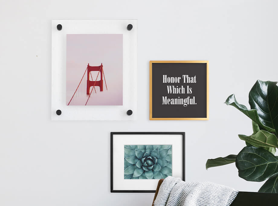 Gallery wall featuring three different Artifact Uprising photo frames above armchair
