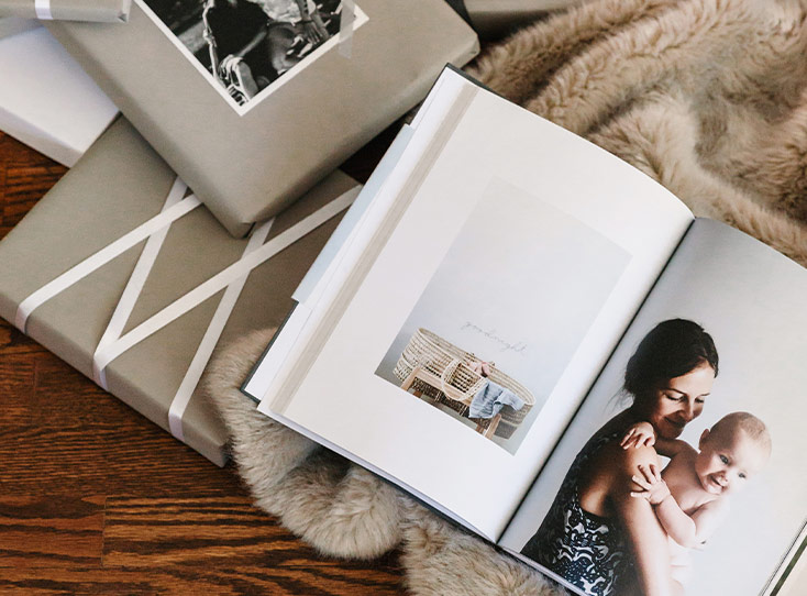 Open photo book next to wrapped photo gifts
