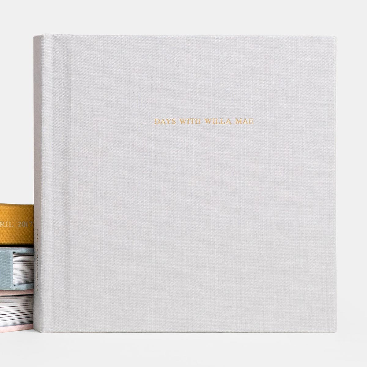 Foil-stamped gold title on cover of Everyday Photo Book titled days with willa mae