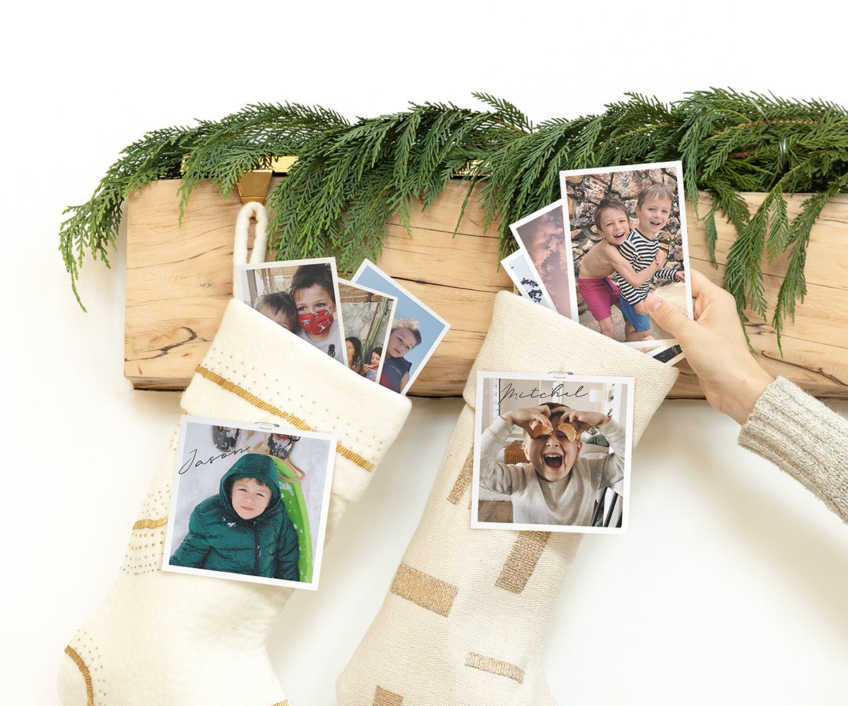 Hand placing photo print on top of wrapped gift as gift tag