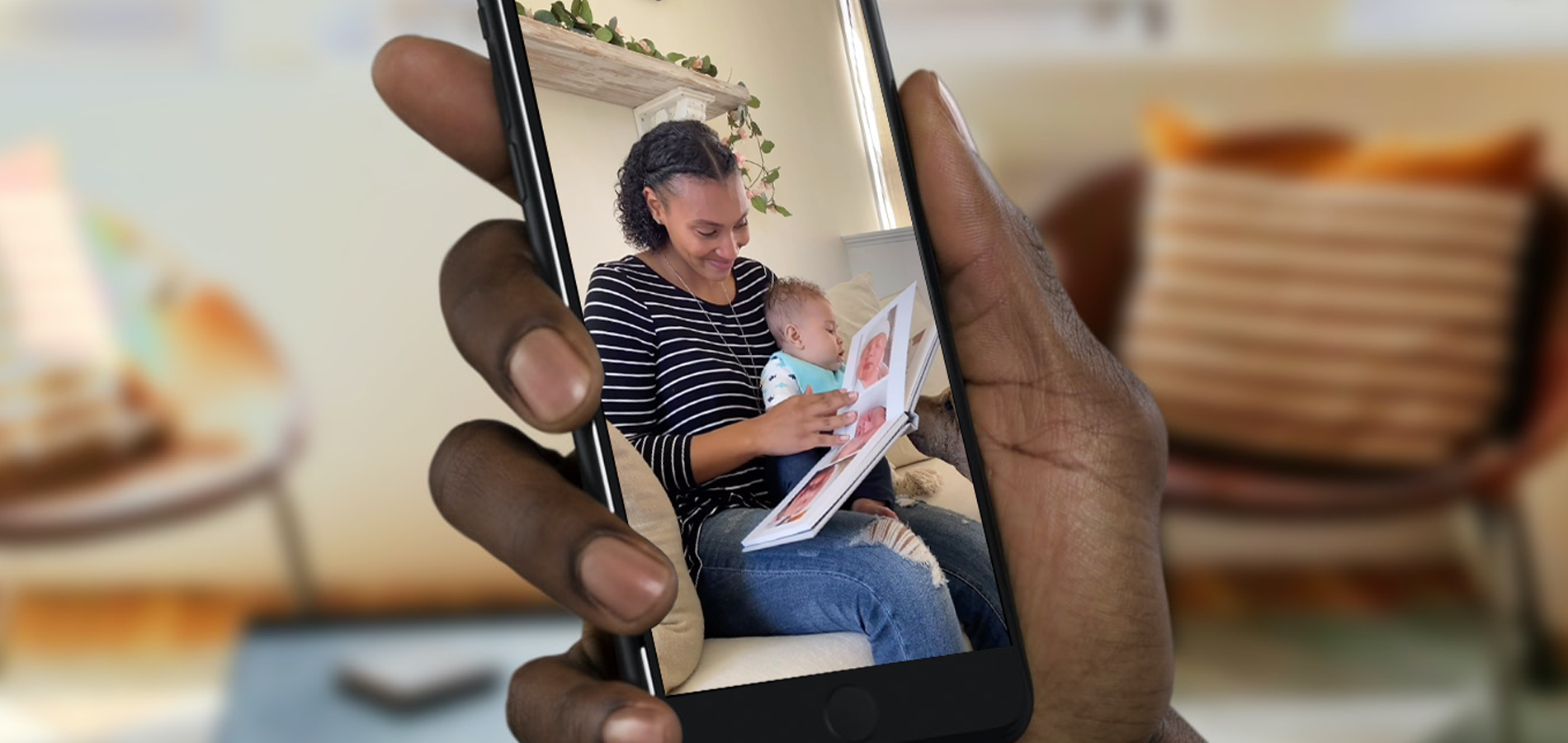 Hand holding phone for video chat with woman opening photo gift