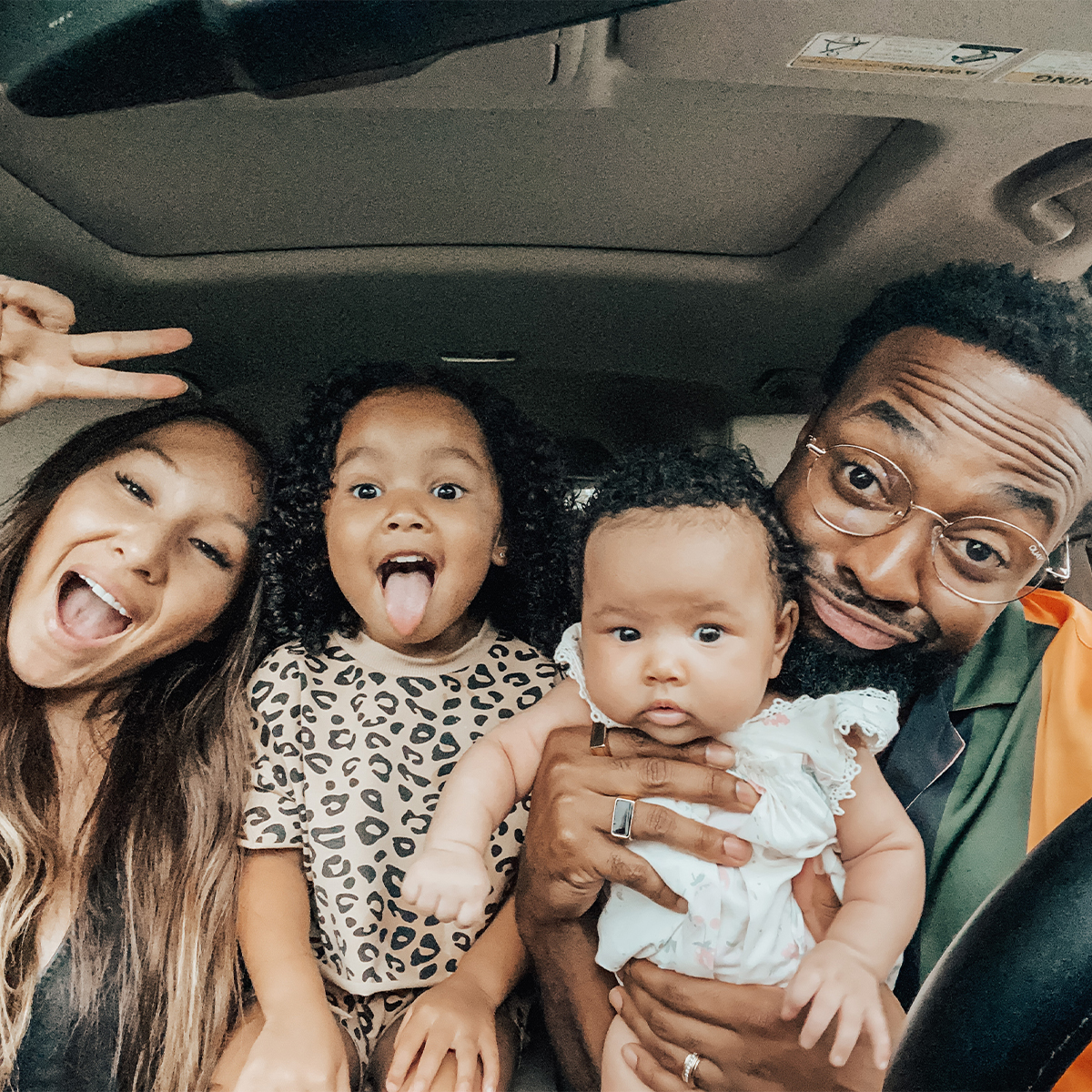 Family taking goofy selfie in car