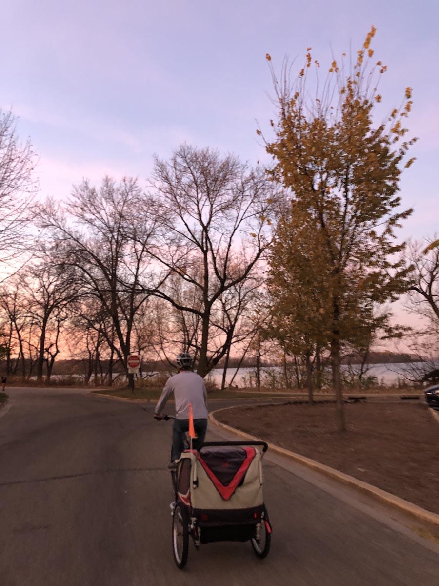 Man riding bike by a lake
