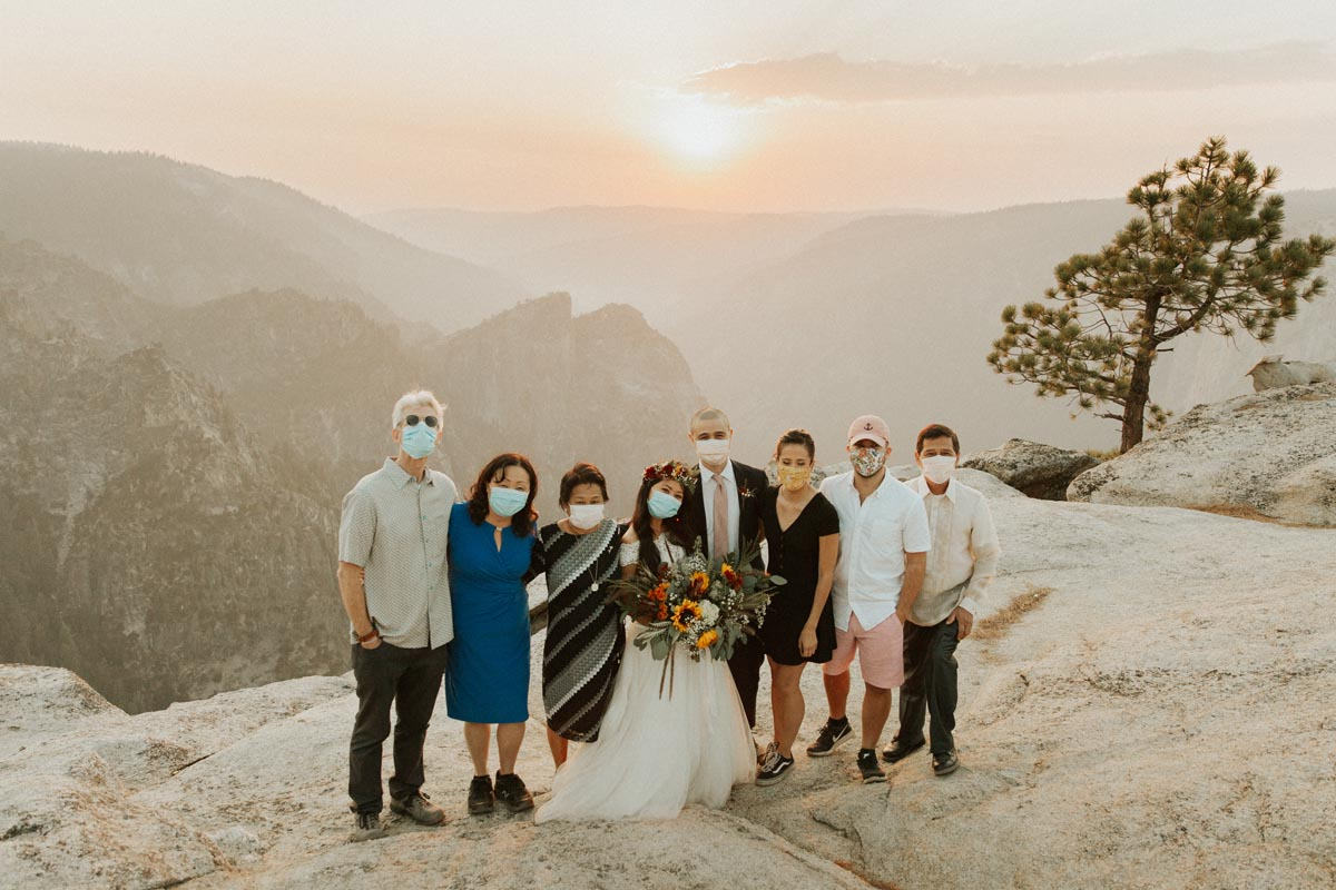 Photo of wedding party wearing masks