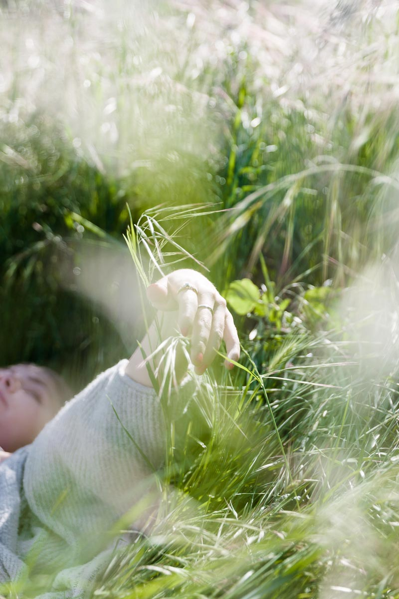 Photo by Kelly Sweda of girl lying in the grass