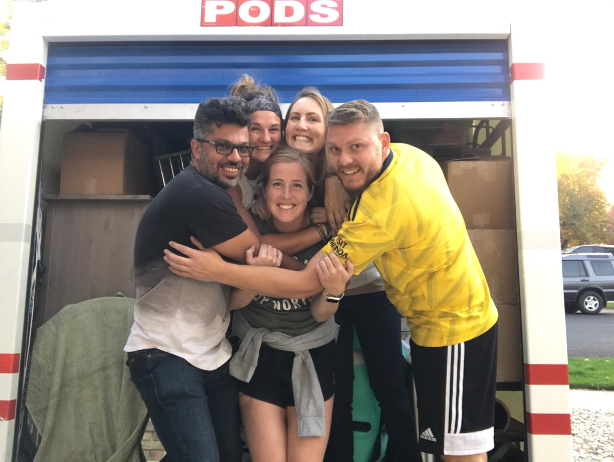 Group hug in front of moving van