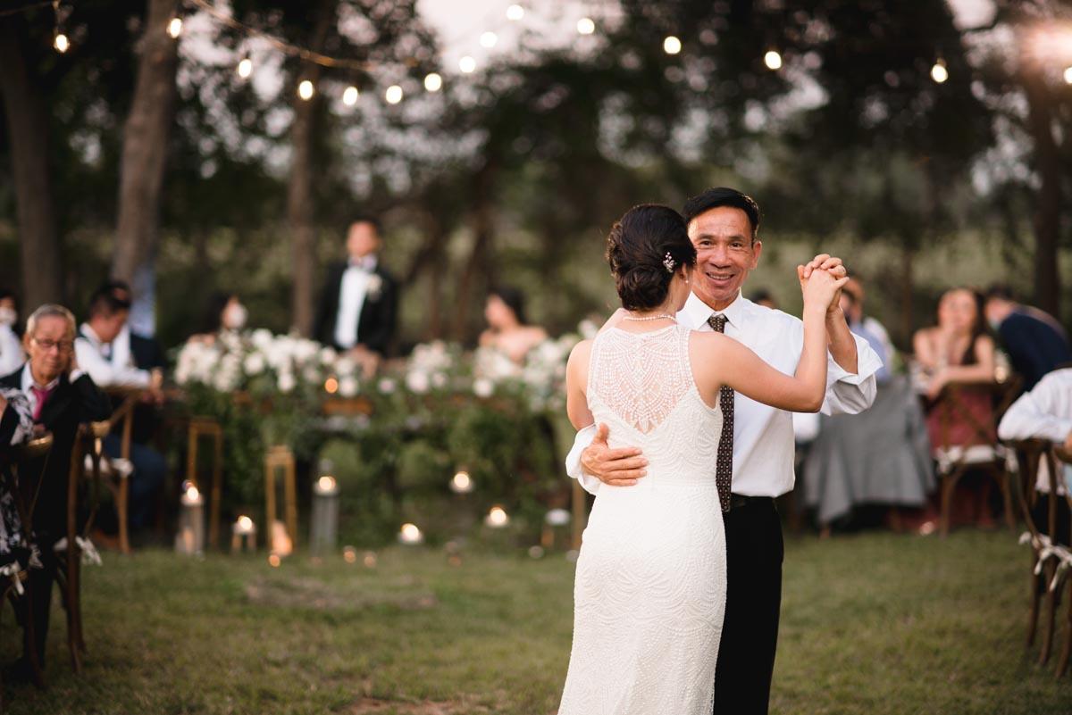 Fatherr and daughter dancing at small backyard wedding
