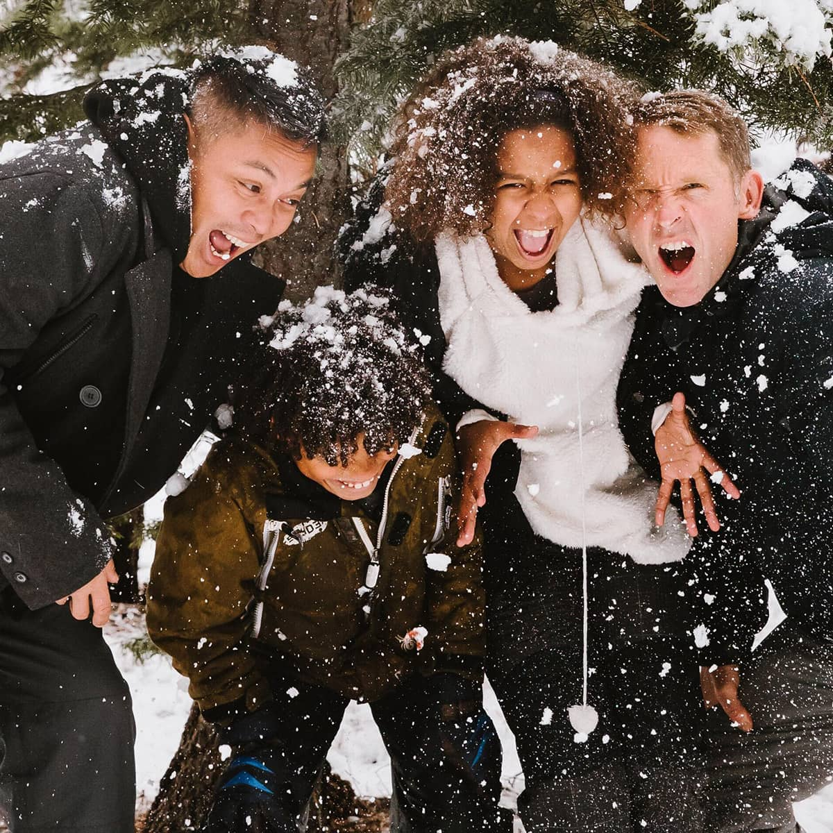 Kids screaming as they play in the snow