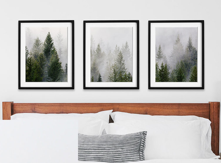 Landscape photo of snowy trees split across three frames in triptych gallery wall