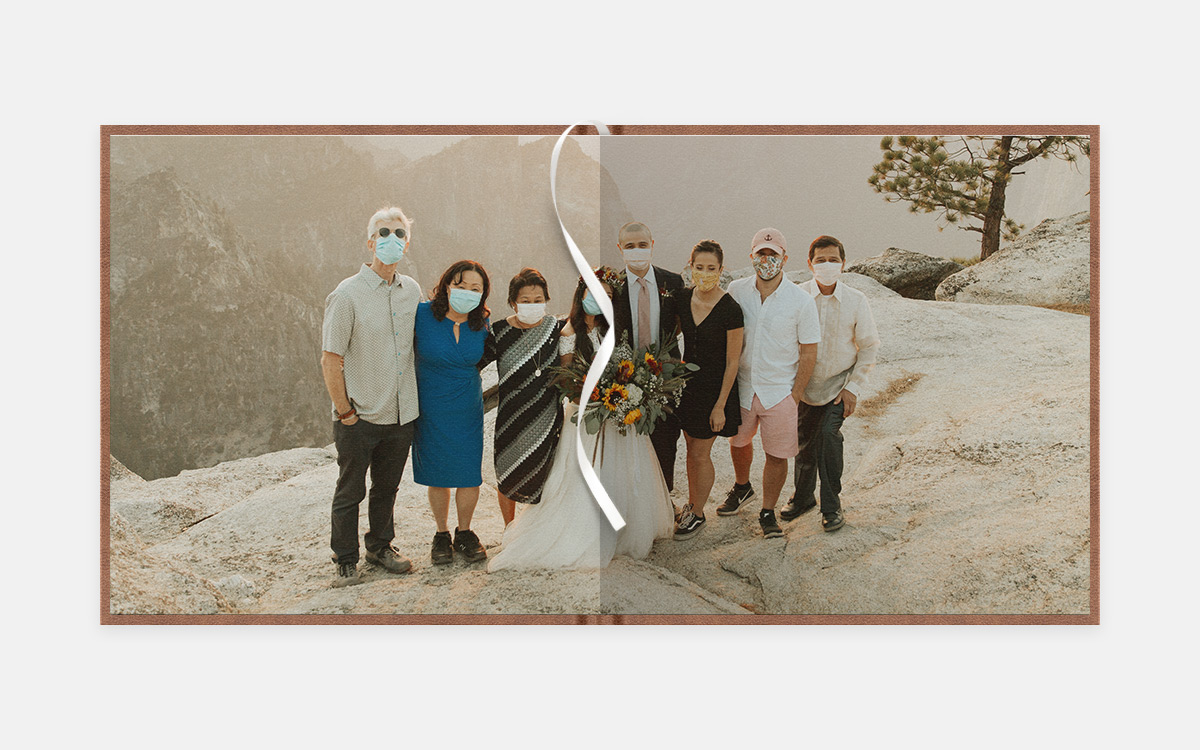 Two page panoramic image of bride, groom, and family at cliffside setting wearing masks
