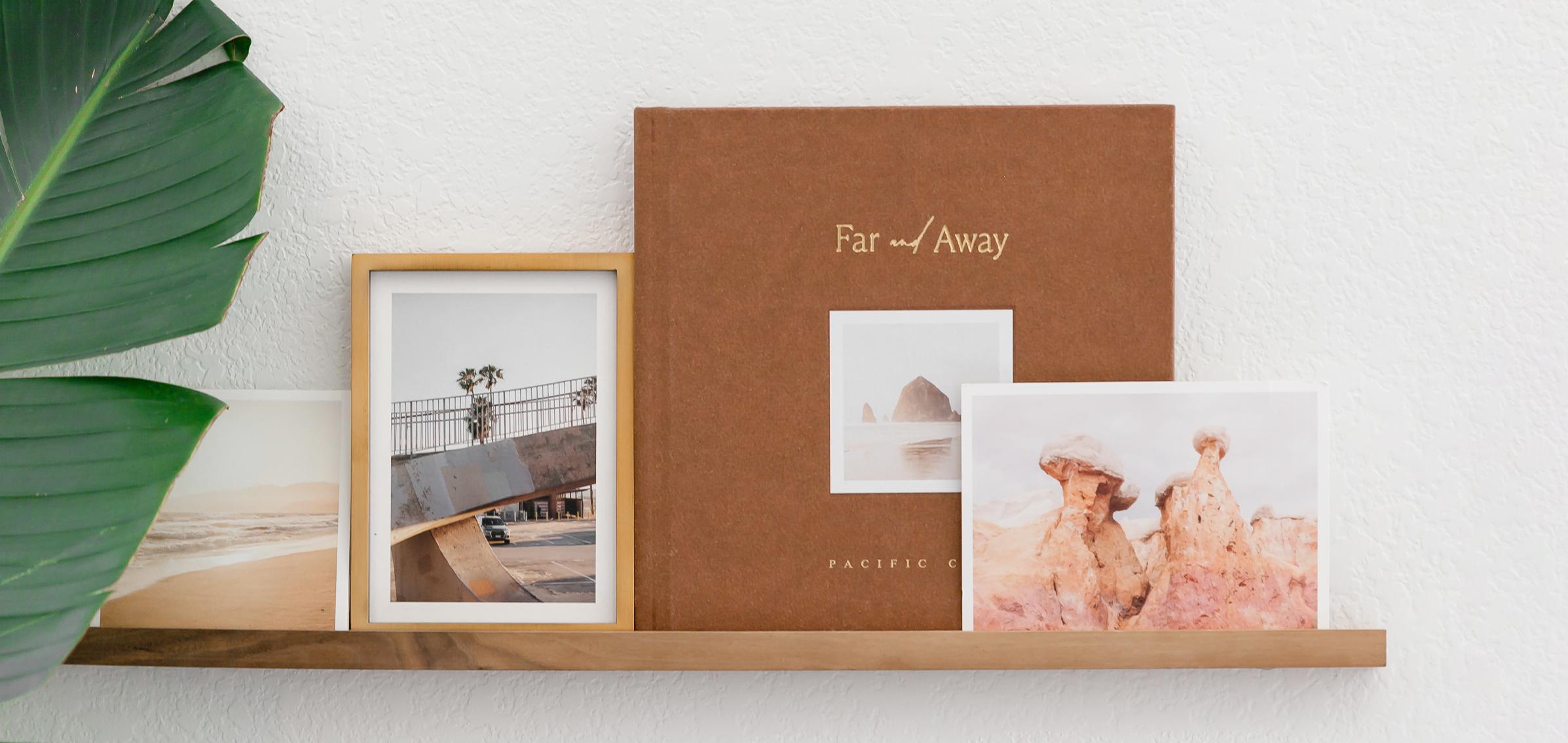 Artifact Uprising photo projects on wooden photo ledge