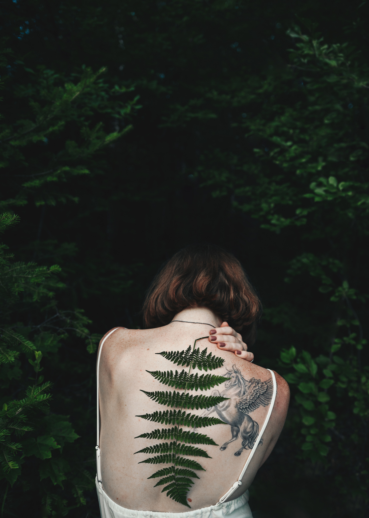 Portrait of woman with back turned to camera by Molly Olwig