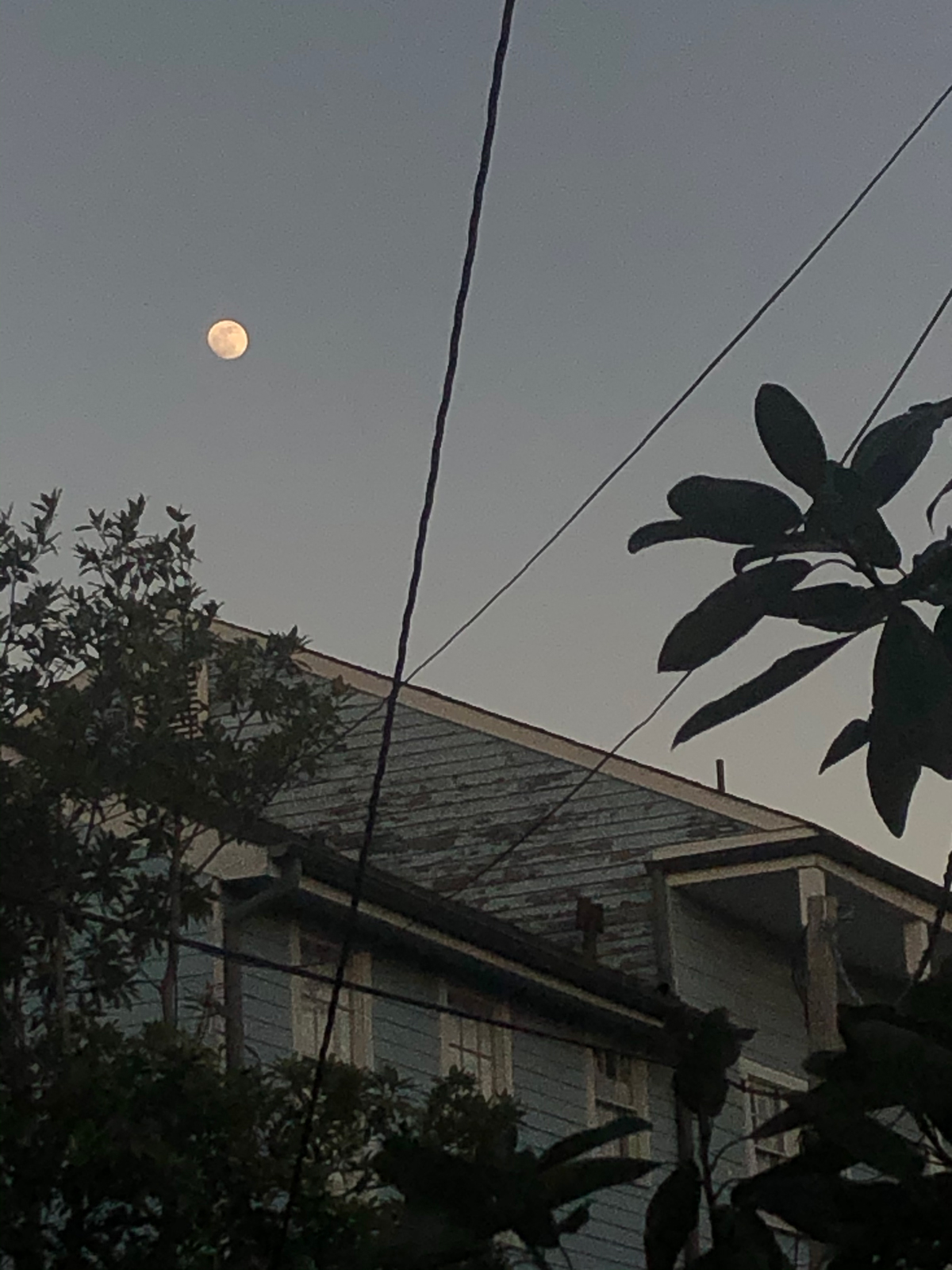 Photo of moon above old house by Molly Olwig