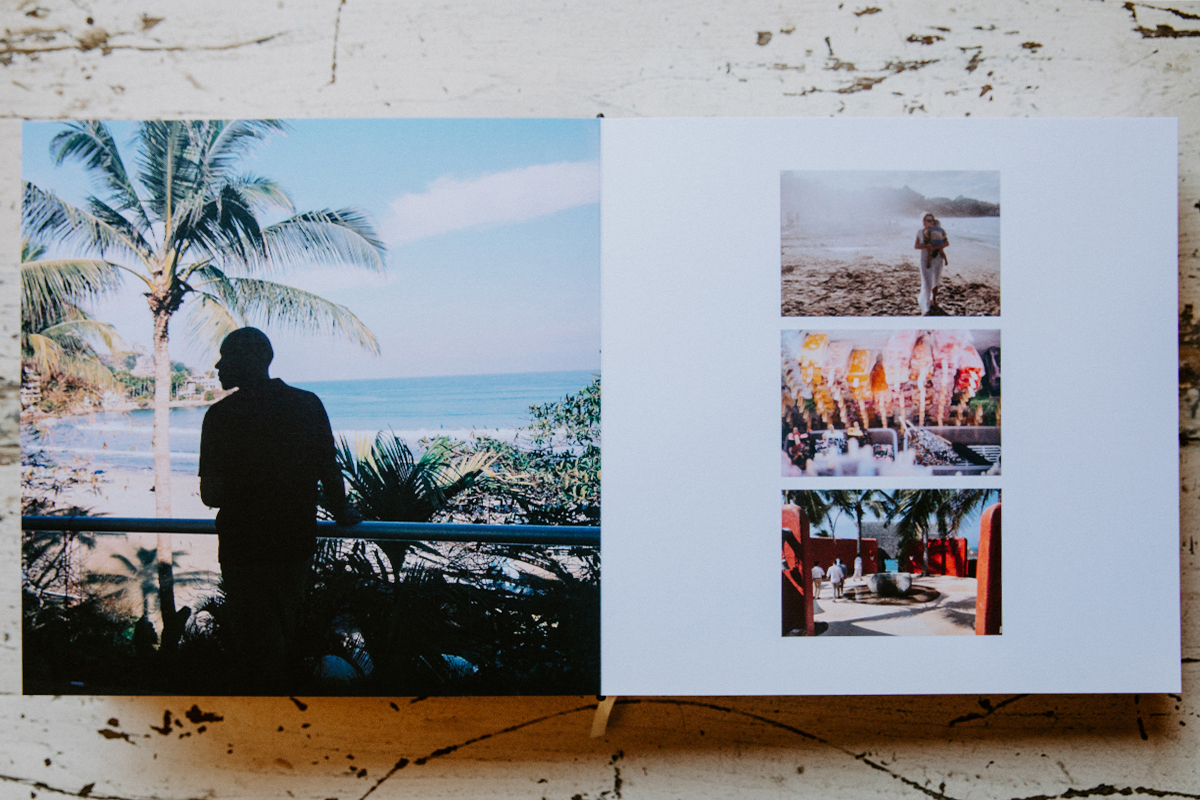 Signature Layflat Album opened to images of various images of the wedding destination