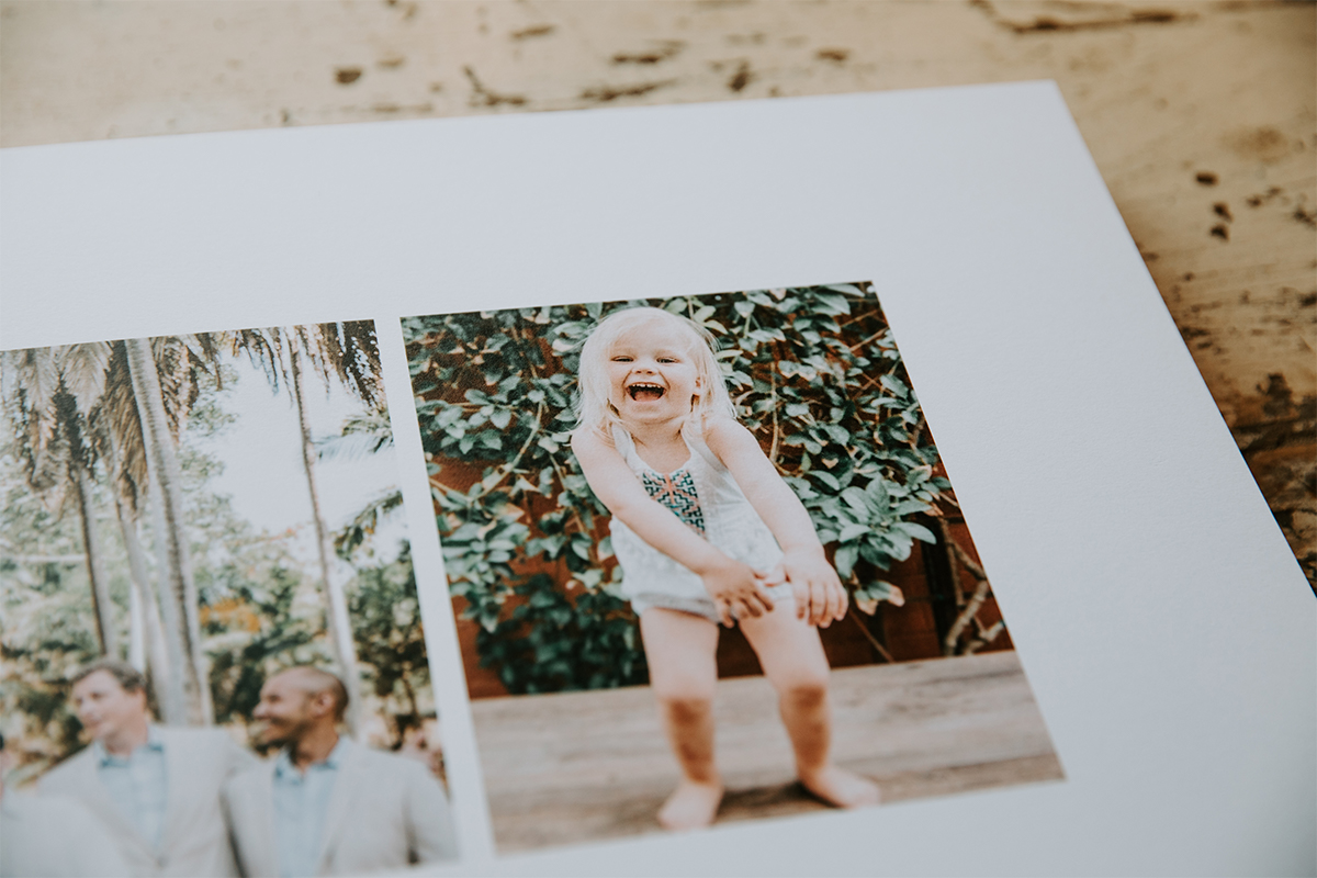 Signature Layflat Album opened to image of little girl laughing and dancing