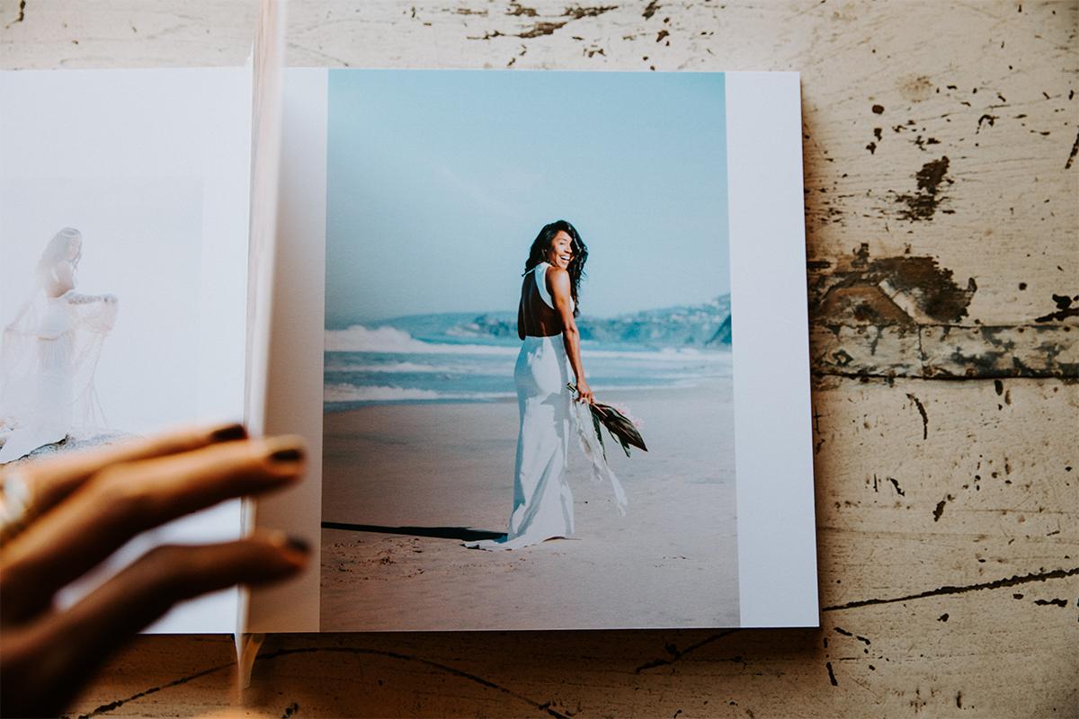 Signature Layflat Album opened to posed photo of bride