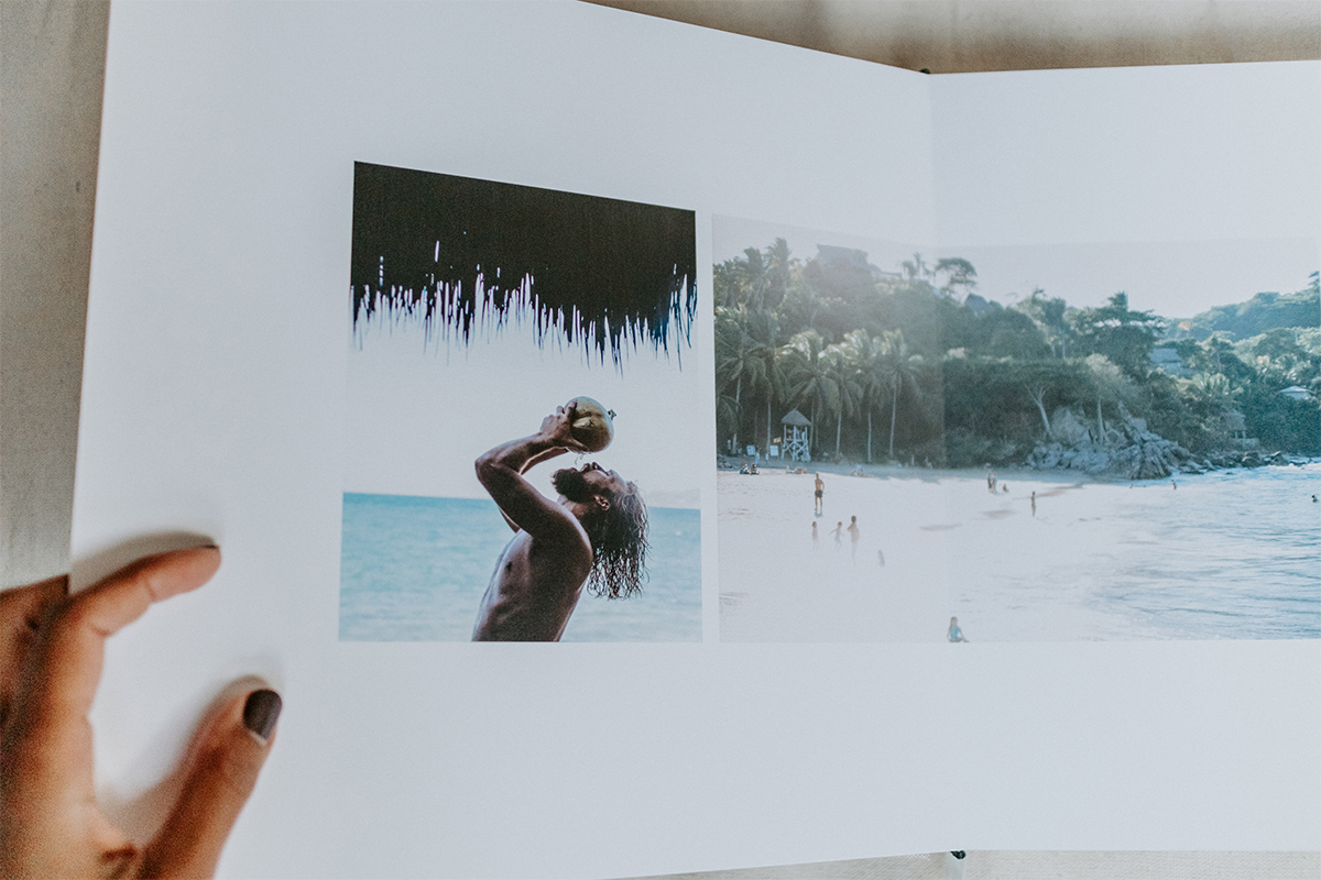 Signature Layflat album opened to image of groom drinking from a coconut