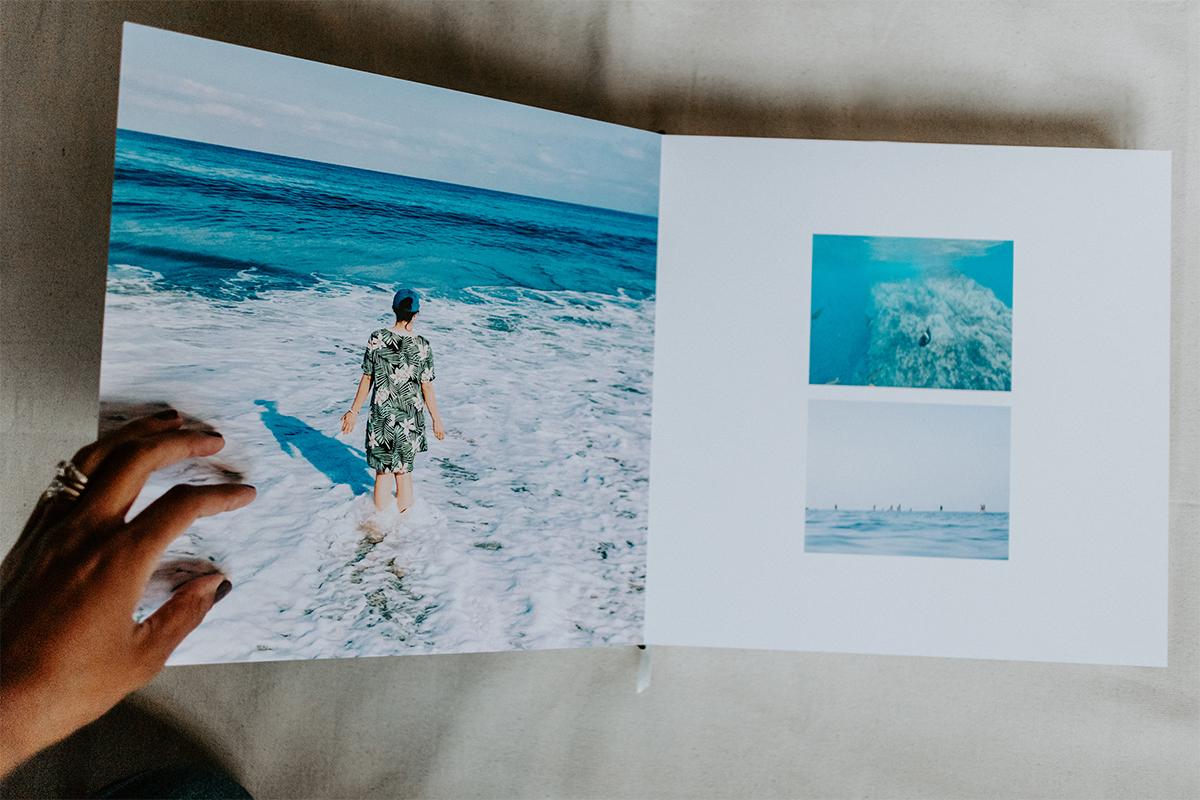Signature Layflat Album opened to series of coastal scenes