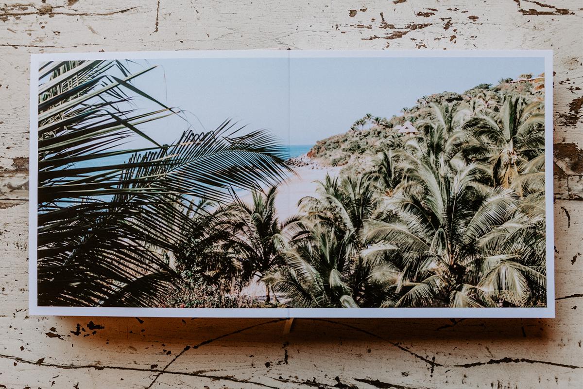 Signature Layflat Album opened to two-page panoramic image of beautiful coastline