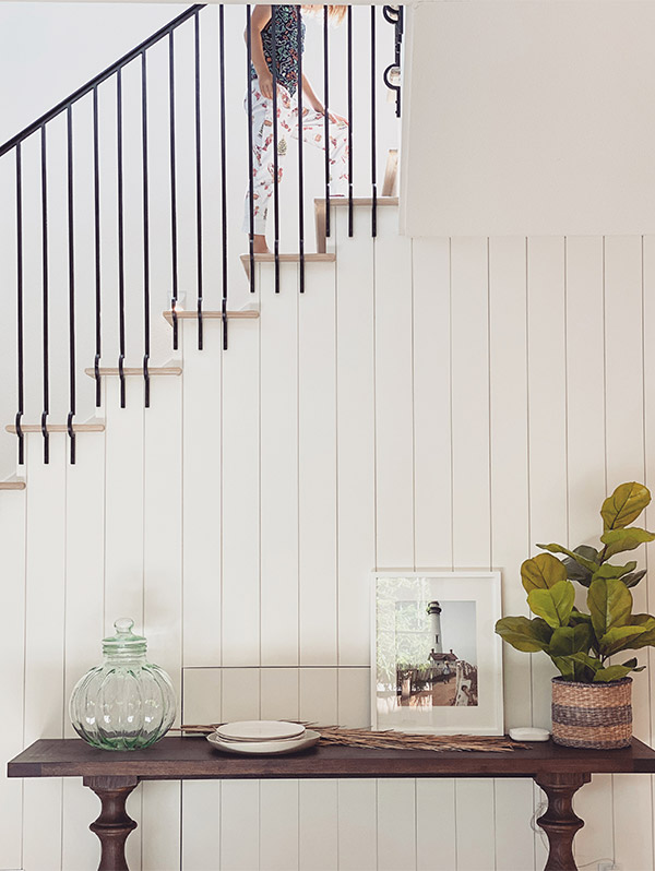 Artifact Uprising Gallery Frame in white on console table in front of staircase wall