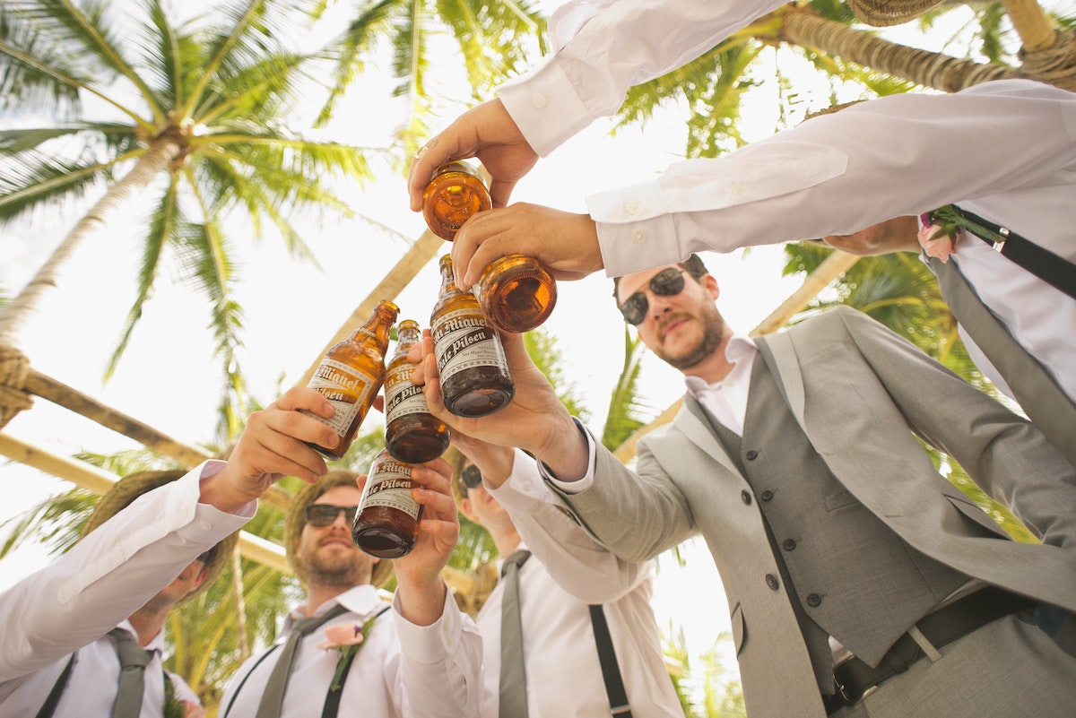 Groomsmen sharing a toast before the ceremony