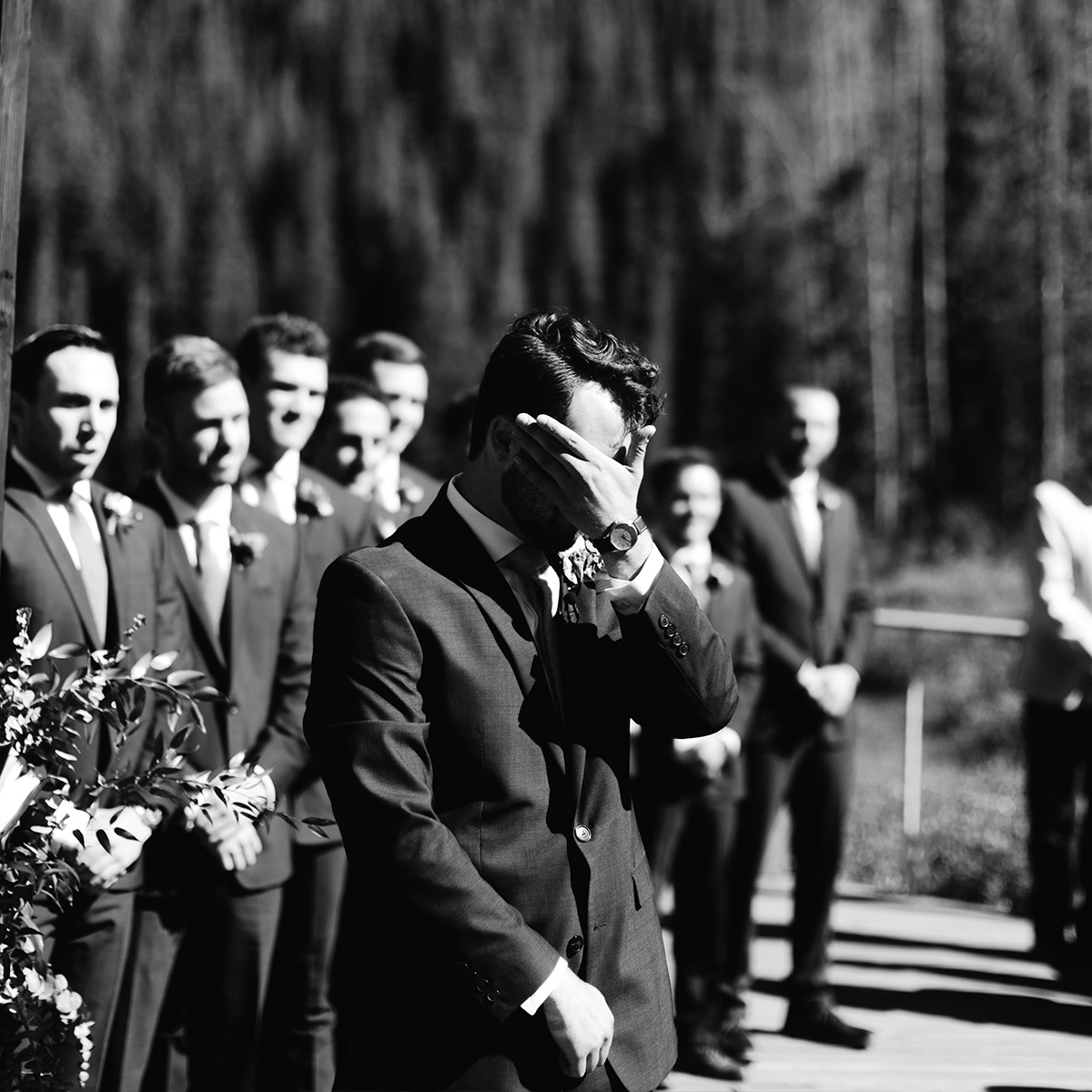 Groom tearing up as he watches bride enter the ceremony