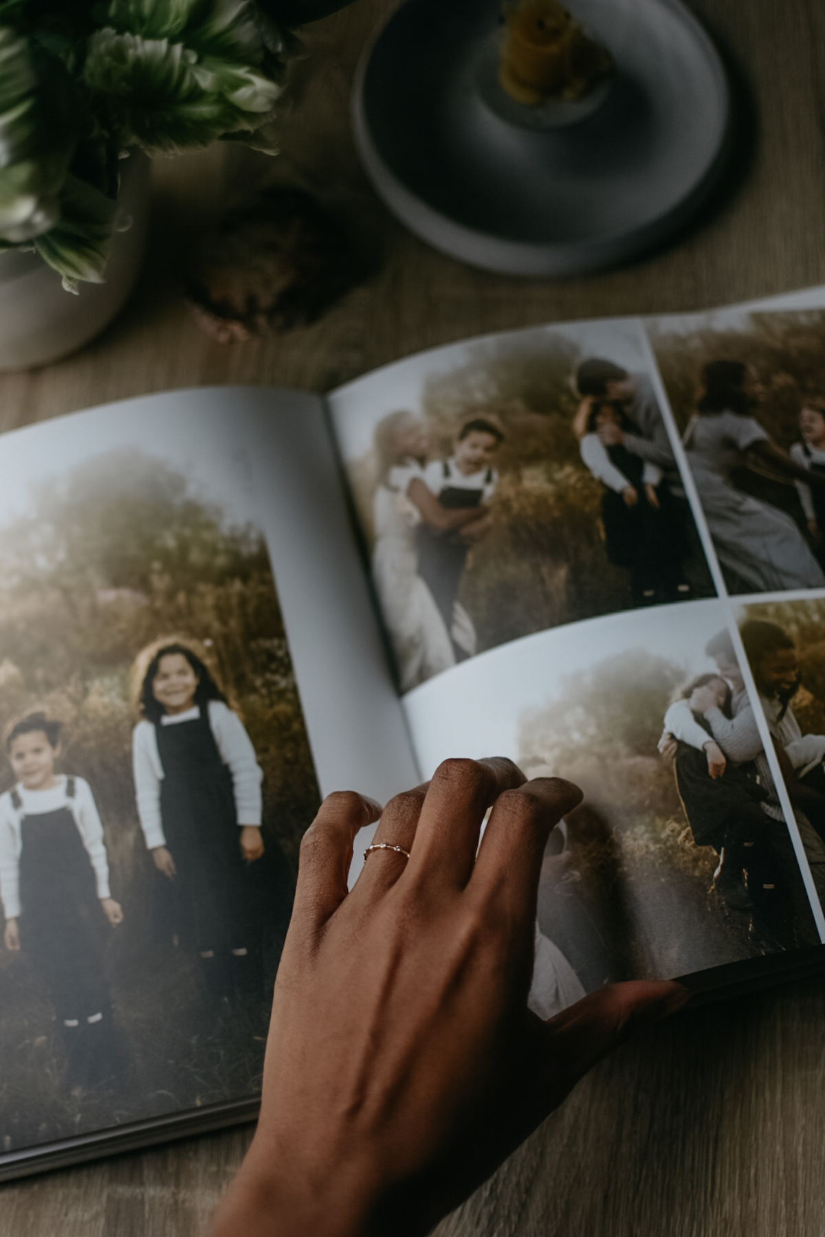 Mother's hand flipping through album filled with photos of her children