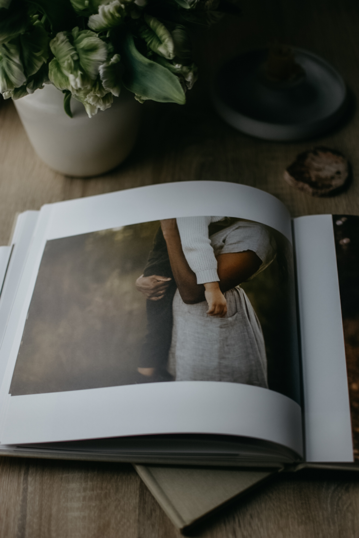 Photo album opened to photo of mother holding young child in her arms