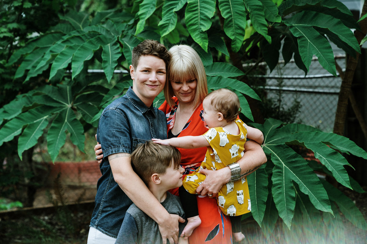 Family portrait with lush green backdrop