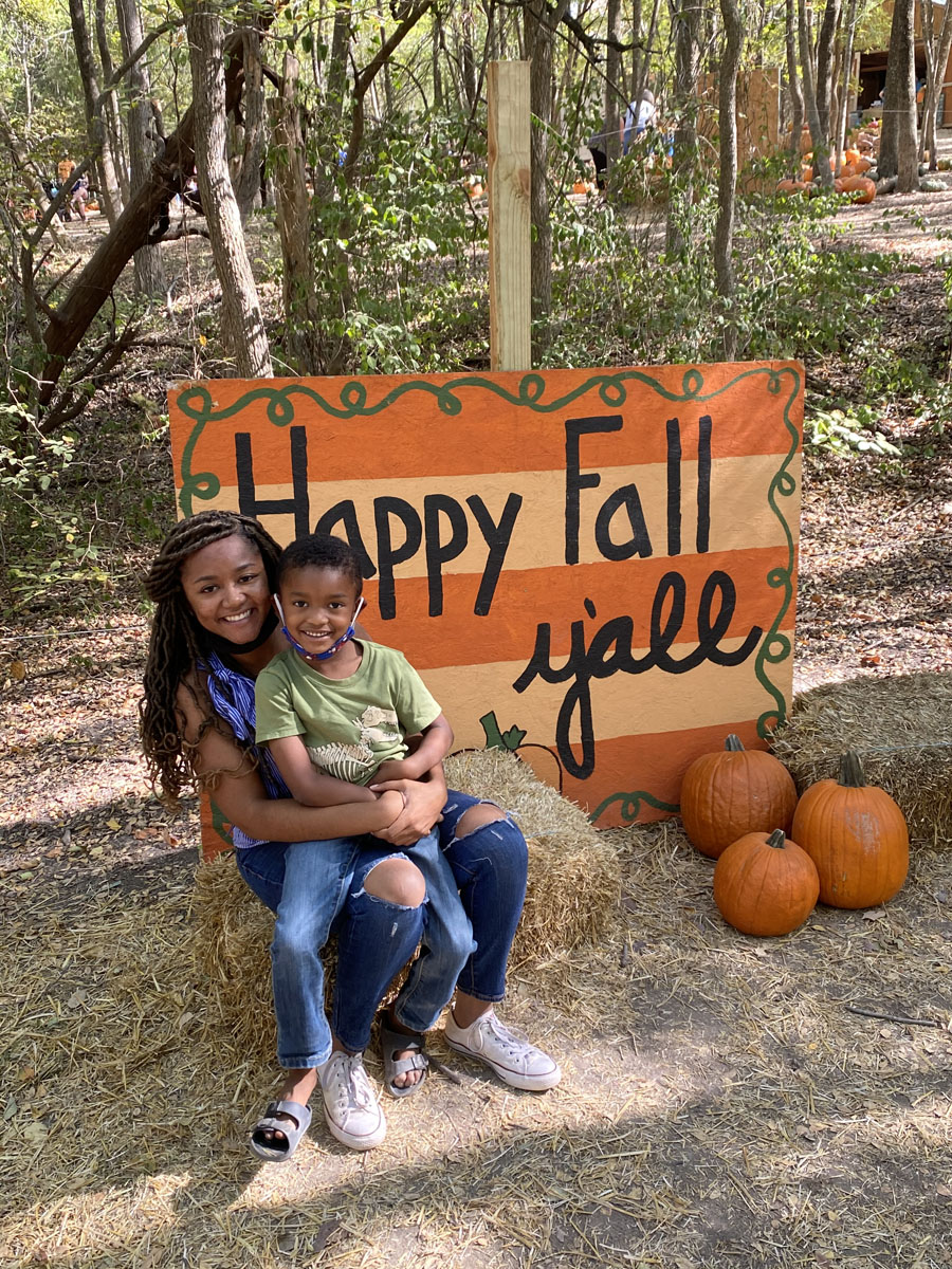 Portrait of mother and little boy at pumpkin patch