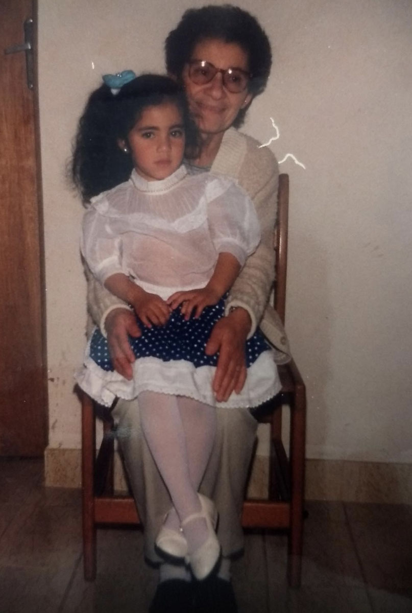 Vintage photo of grandma with granddaughter on her lap