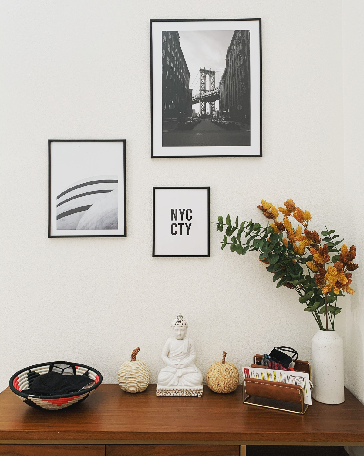 Gallery wall with framed art and photos