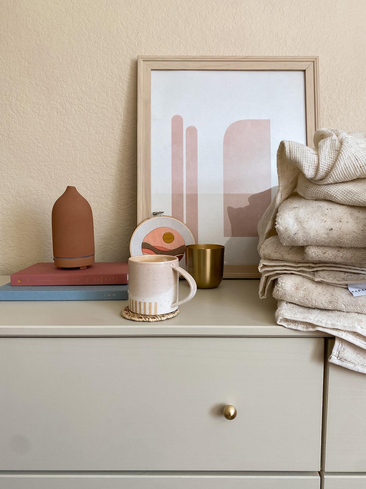 Framed art sitting upright on dresser