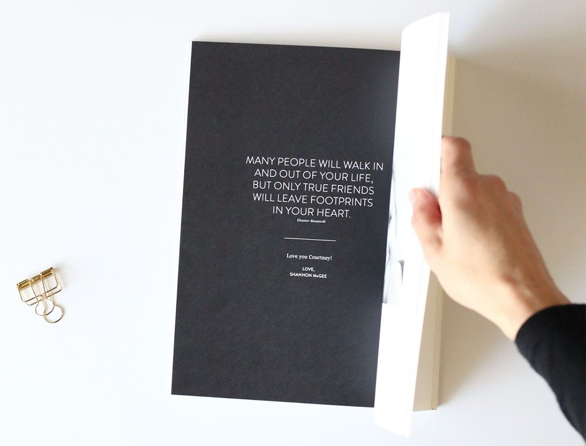 Artifact Uprising Softcover Photo Book opened to dedication page that says many people will walk in and out of your life, but only true friends will leave footprints in your heart