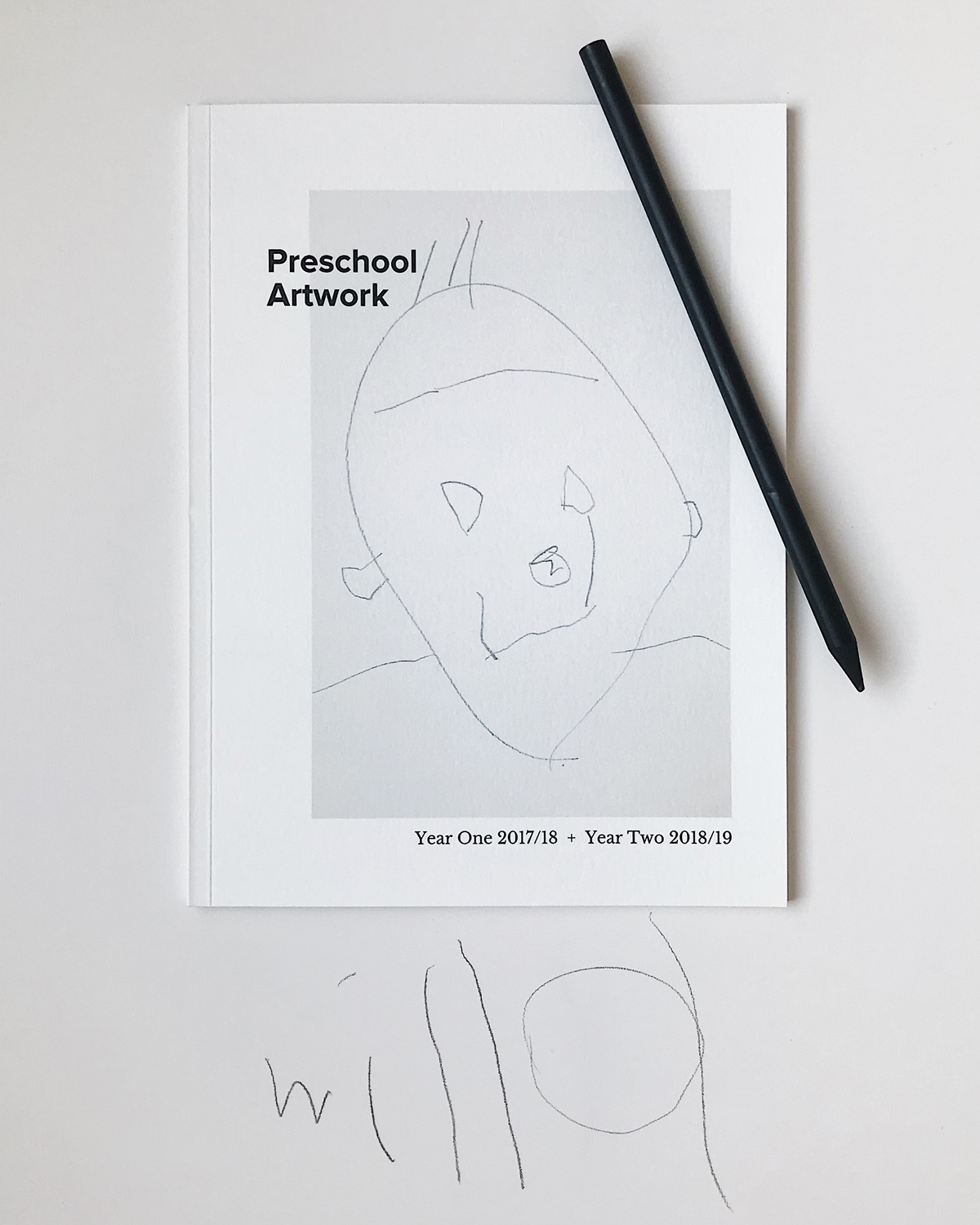Artifact Uprising Softcover Photo Book featuring child's drawing and titled Preschool Artwork
