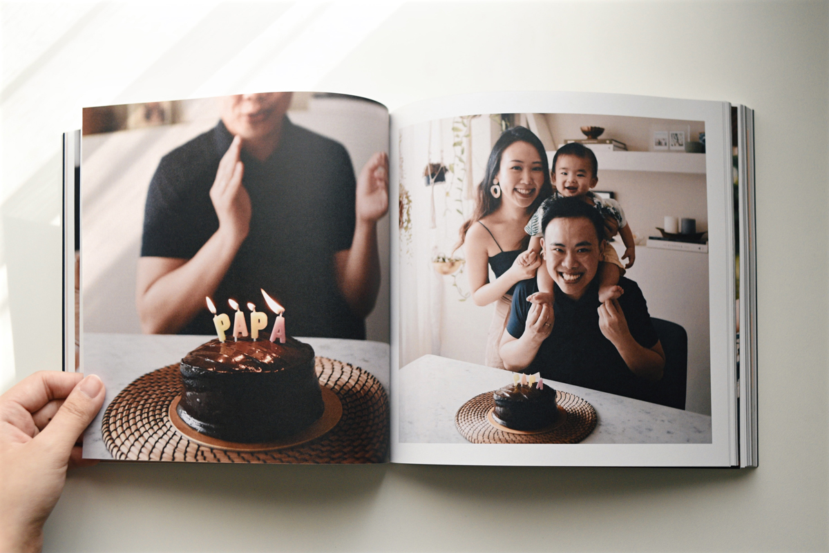 Artifact Uprising Color Series Photo Book opened up to family photos from dad's birthday