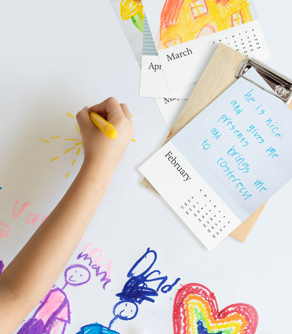 Child's hand drawing next to Artifact Uprising Wood Calendar featuring notes they wrote to dad