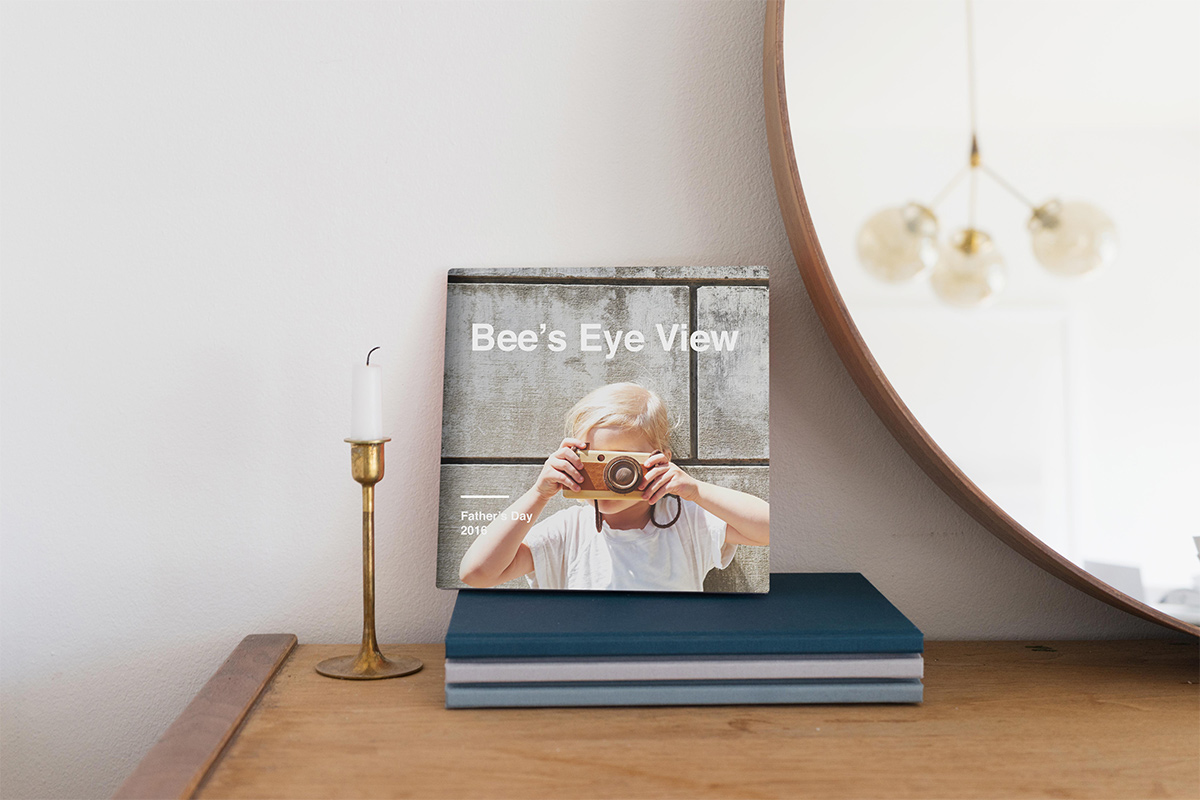 Artifact Uprising Hardcover Photo titled Bee's Eye View featuring photo of little girl looking through camera